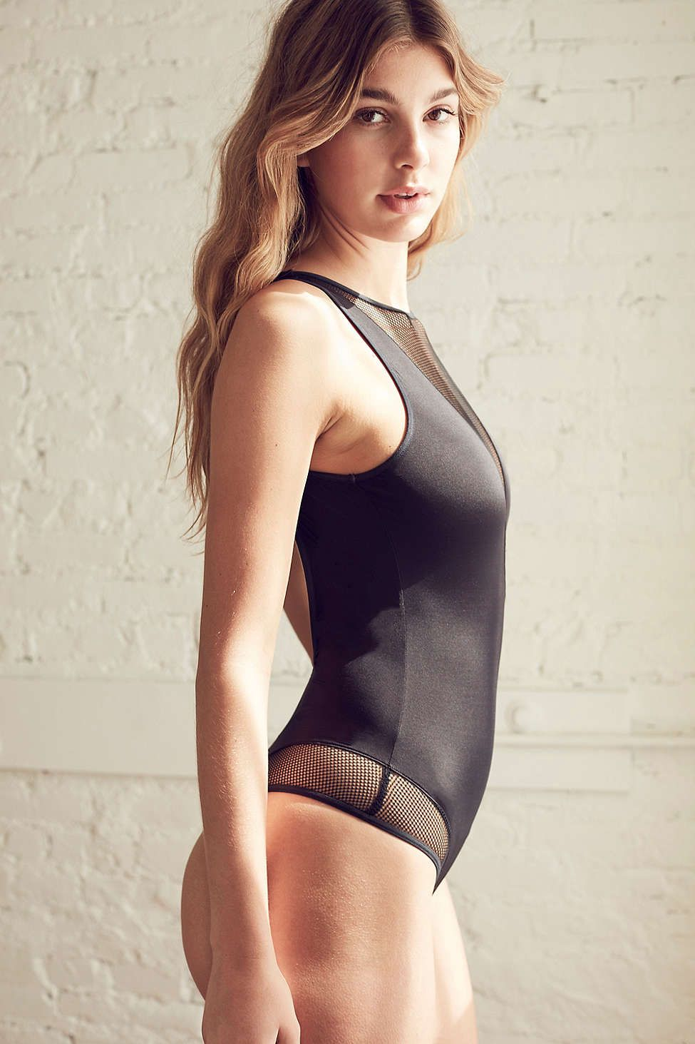 cea072b43a4 Calvin Klein Id Fishnet V-Back Bodysuit - Urban Outfitters